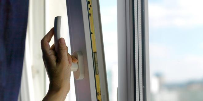woman opening window for fresh air